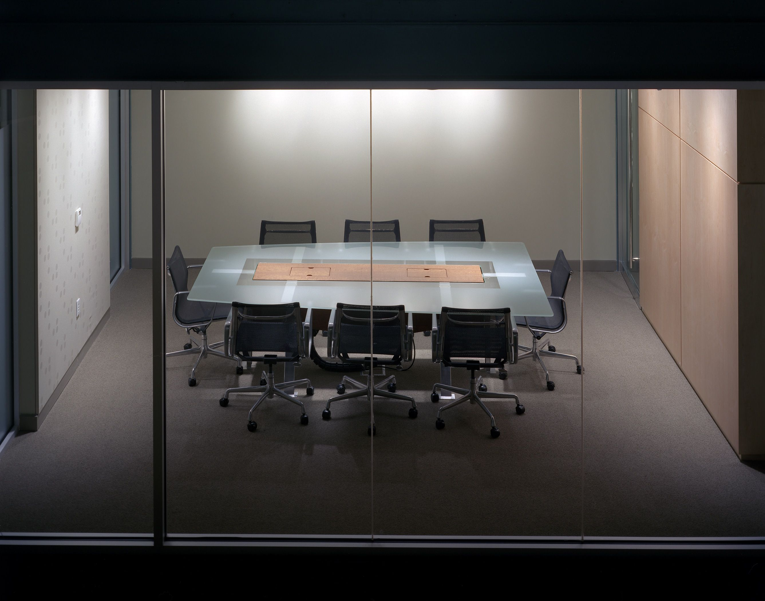 conference table with frosted glass table top outside looking in