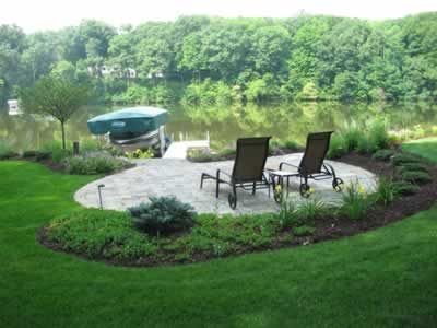Patio Seating Area Overlooking Private Pond Landscaping