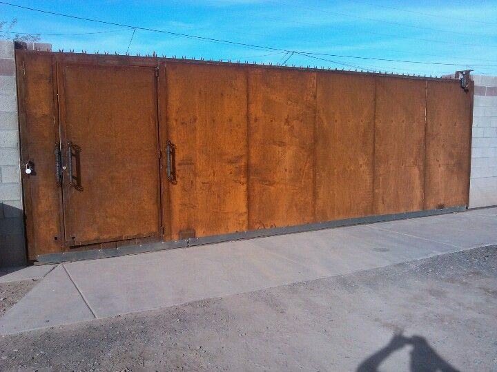 Massive 26 Foot Long 9 Feet High Rolling Gate By With A Door By John Diaz Metal Fence Gates Doors Backyard