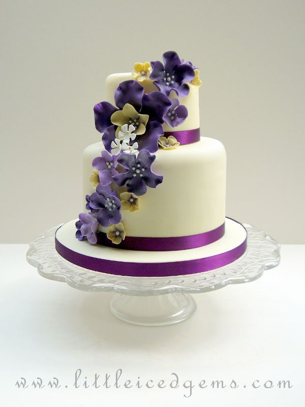 Two Tier Wedding Cake With Purple Cascading Flowers Www Littleicedgems Com Tiered Wedding Cake Cake Cupcake Cakes