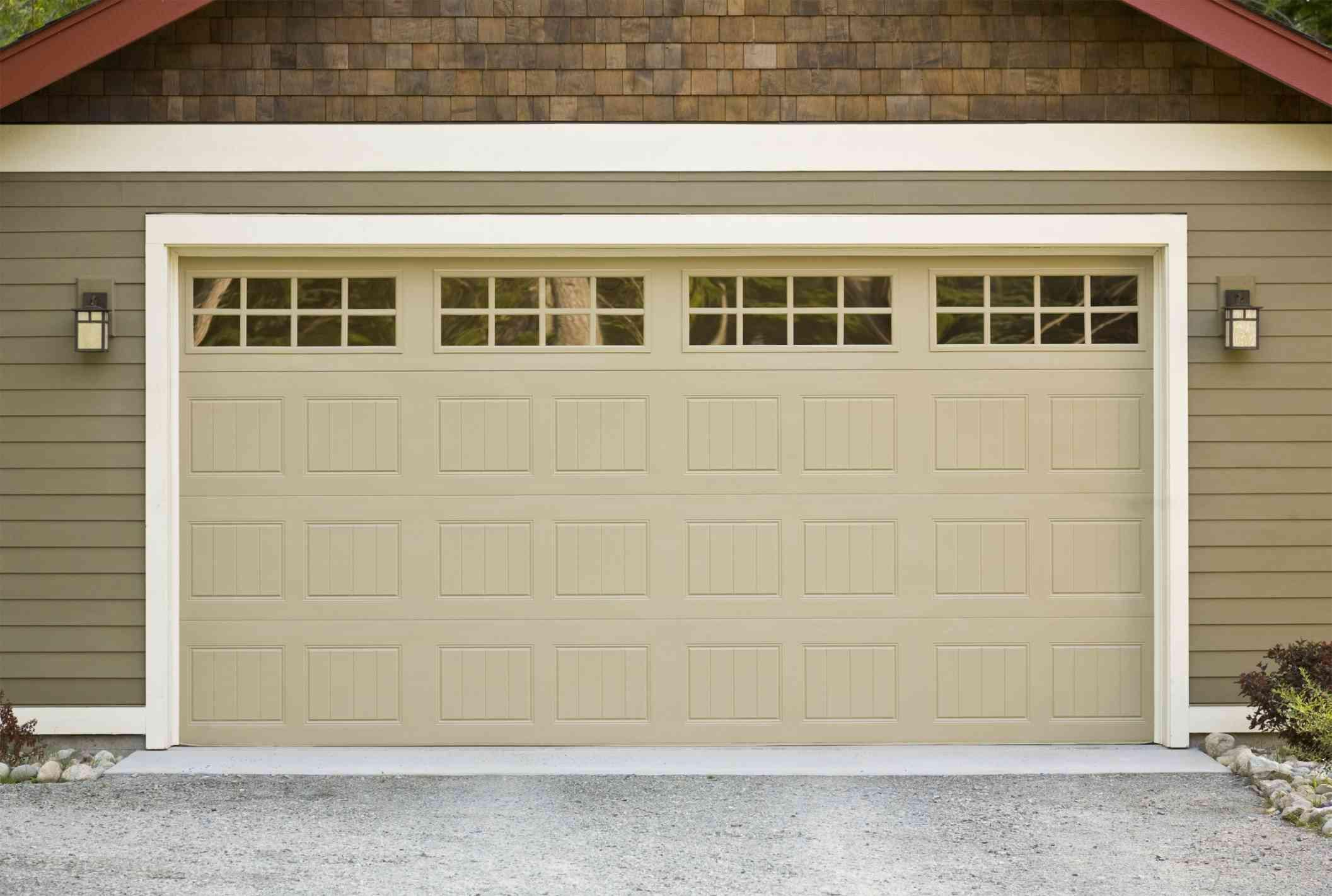 Replacing Your Garage Door We Answer Your Top Cost Concerns Garage Door Design Garage Door Cost Garage Insulation