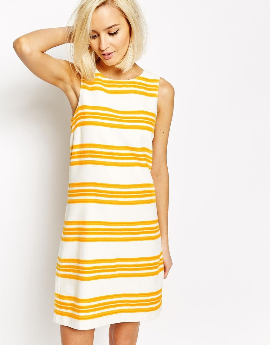 Cute summer dress would pair great with brown heels style and