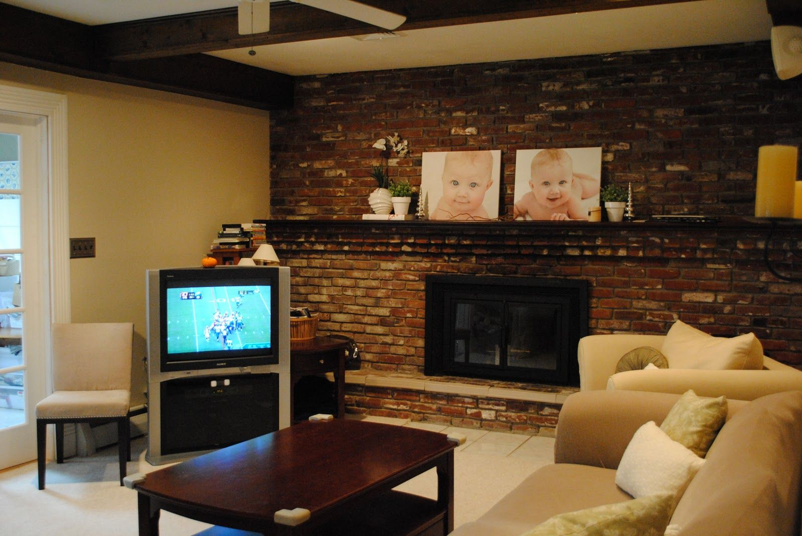 Stunning Country Living Room Style With Brick Wall And Fireplace Along Table Lamp Near White