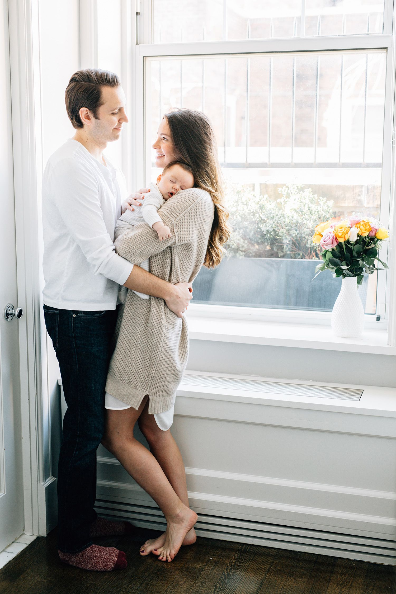 This nyc lifestyle family session was one of my favorites. We were able to  shoot at a beautiful nyc penthouse filled with natural dreamy light, it was  perfect for their lifestyle session! It was so sweet watching Janelle and  Ryan cuddle and snuggle baby Jack all afternoon. He loved it so much