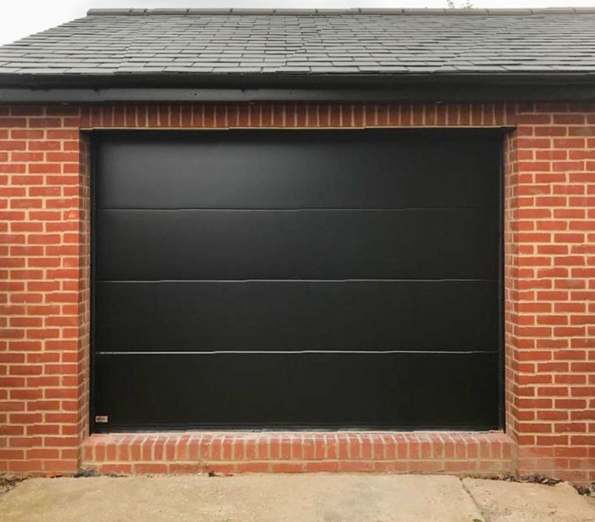 An Sws Seceuroglide Sectional Unribbed Elite Garage Door Finished In A Smooth Black Garage Doors Sectional Garage Doors Black Garage Doors