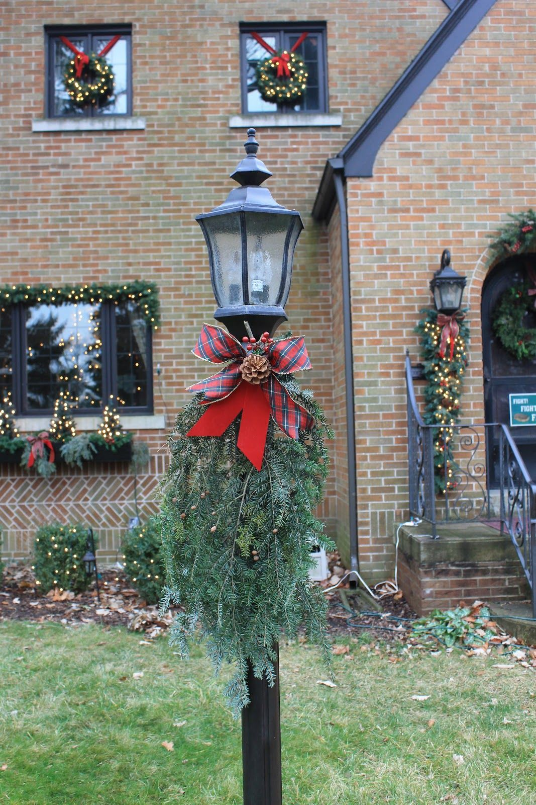 Holiday lamp post - just a few evergreen sprigs and ribbon ...