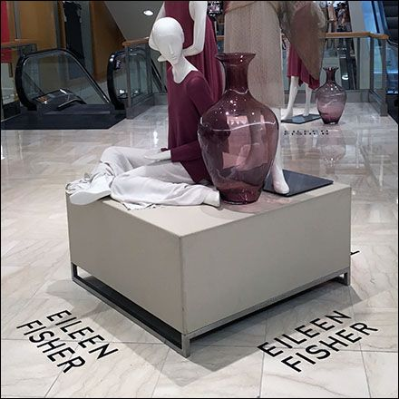 """The floor graphic itself is simply """"Eileen Fisher"""" spelled out in sans serif…"""