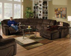 The Championship Chocolate Reclining Sectional Is Covered
