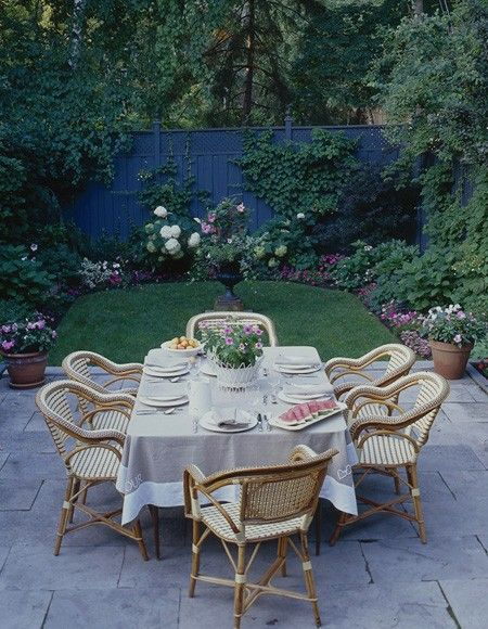 patio dining with arched green space and rose garden