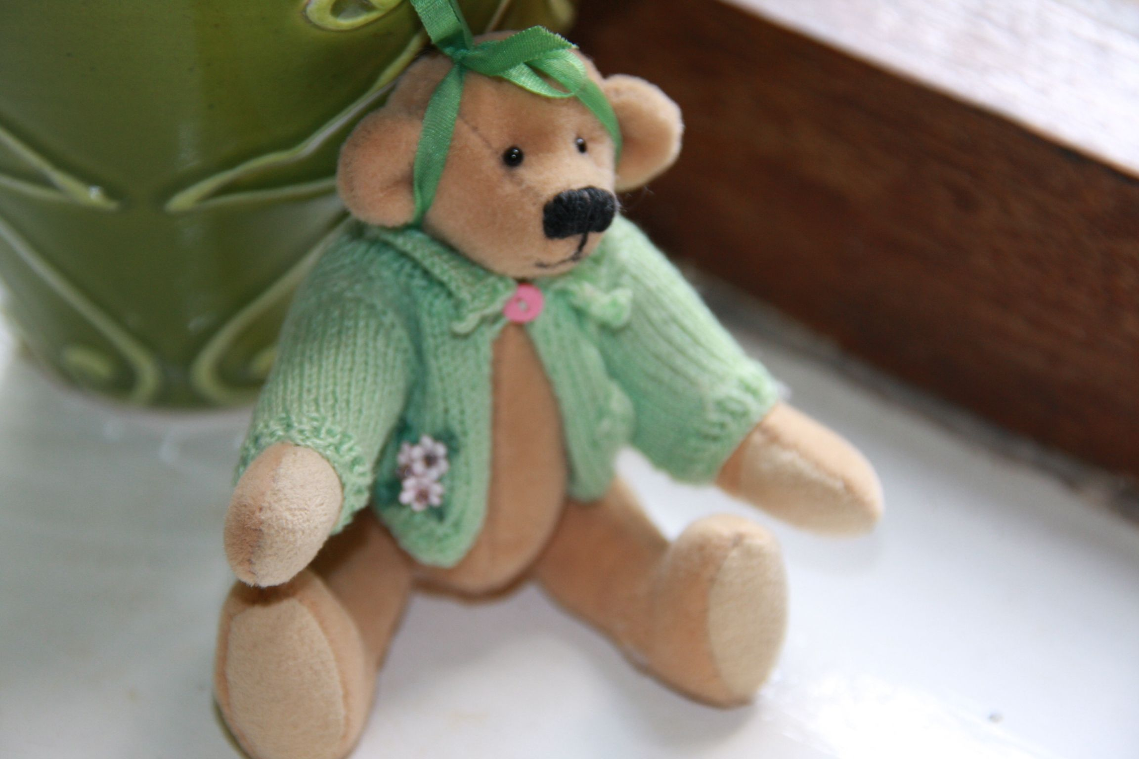 Miniature bear....I knitted the jersey with sewing needles and cotton... :-)