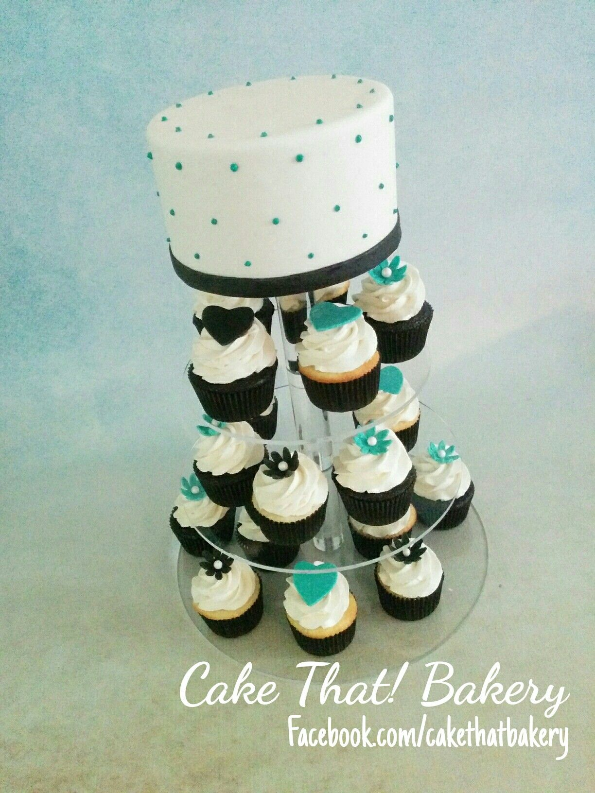 Black and teal cupcake tower