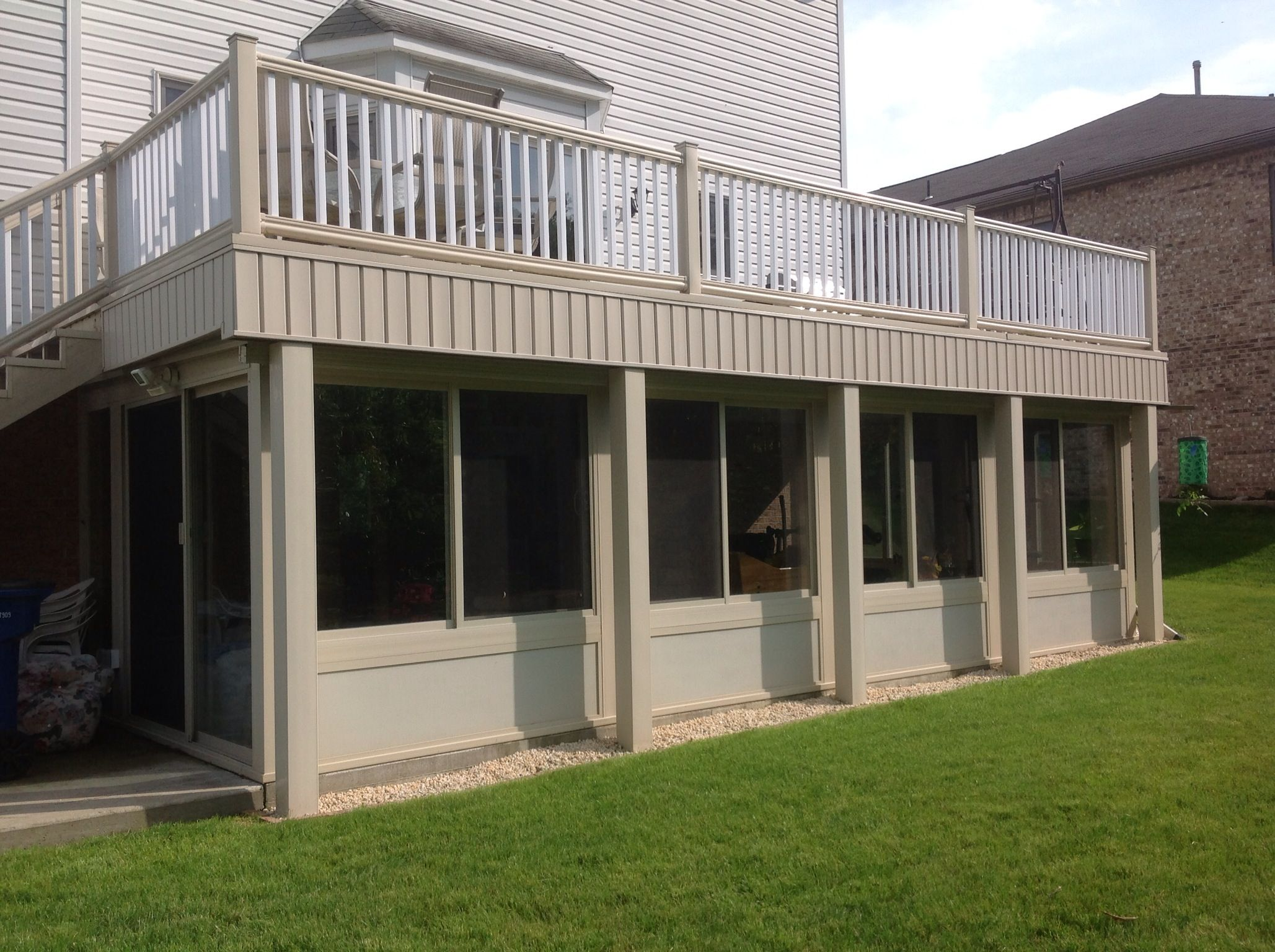 This is an all season sunroom we built under our composite for Building a composite deck