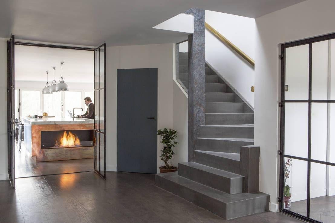 Een betonlook trap is helemaal trending in interieur land. het past