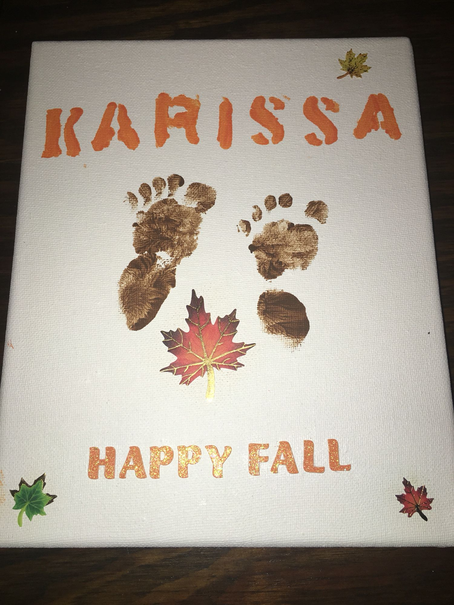 Cute DIY feet or hand print craft for Mommy and Daddy to do with baby or young child.  Great gift for all holidays and special occasions. All materials bought from Walmart.  Canvas, safe non-toxic water base paint, stickers, craft glue, stencil letters, Make it with your own special touch. We did a fall theme.