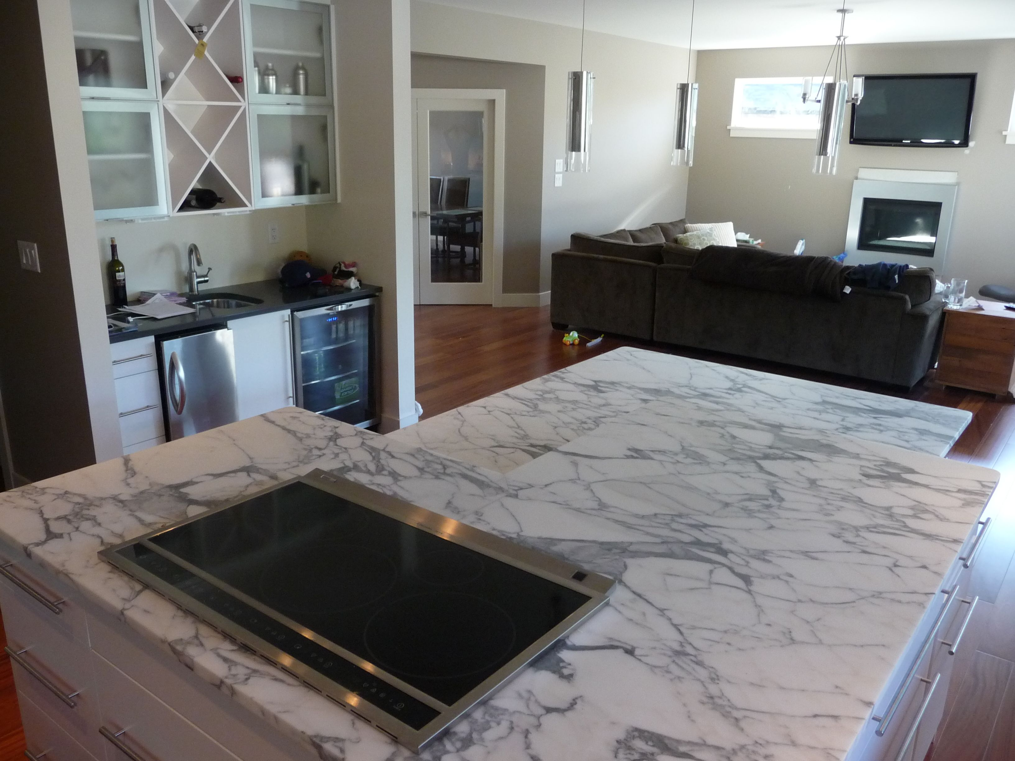 two level kitchen island in arabascato marble and perimeter tops