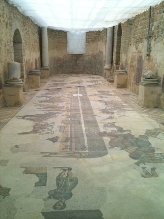 Villa Romana del Casale in Piazza Armerina, Sicilia, Italy - built in the first quarter of the 4th century - view of the Circus Mosaic with chariot races in the Circus Maximus of Rome - depicted on the floor of the Palaestra of the Baths