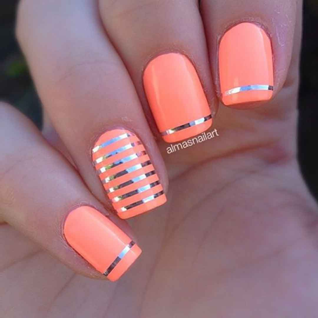 Neon Orange Matte Colored Nails With Hints Of Silver Metallic Strips Added On Top For Effect Graphic Design