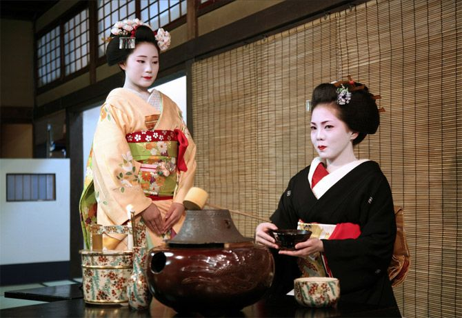 Geiko Mamechika prepares tea before Miyako Odori, the annual spring dance of the Gion Kobu district. Her younger sister, Mamechiho (the most popular maiko in Gion), waits patiently until it is ready to serve to the guests. Photo by Melissa Rose Chasse