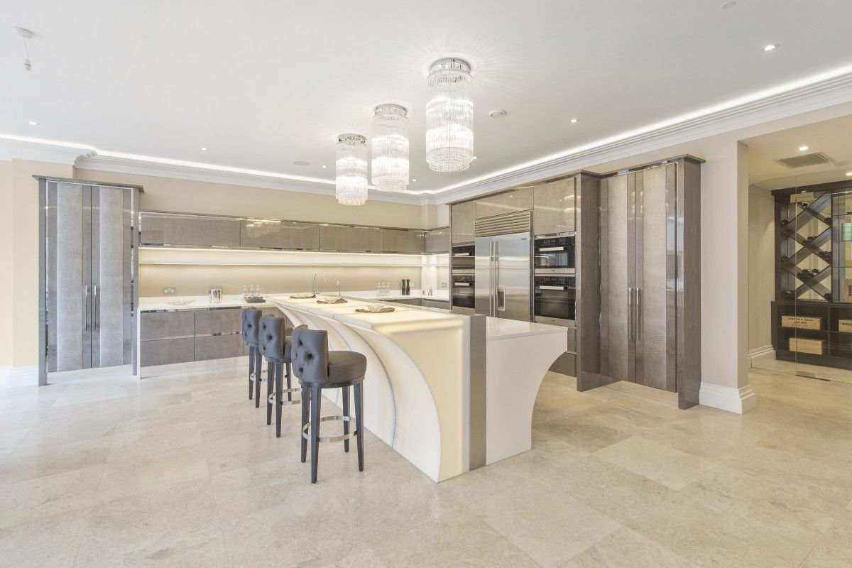 High gloss figured sycamore veneer kitchen. With mirror polished ...