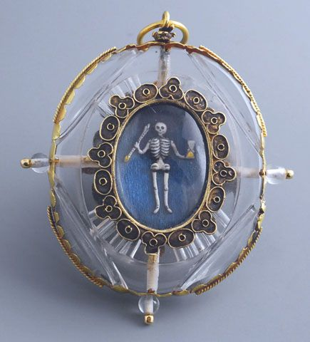"Rock crystal pendant, shaped as a locket with two views, gold-mounted. On one side is a scene of Golgotha, composed of small figures in carved ivory. The other is an exceptional ""memento mori"", showing a skeleton in enamelled gold, a hand holding the hourglass of Time and the other a deadly arrow. Milan, late 16th century - early 17th century."