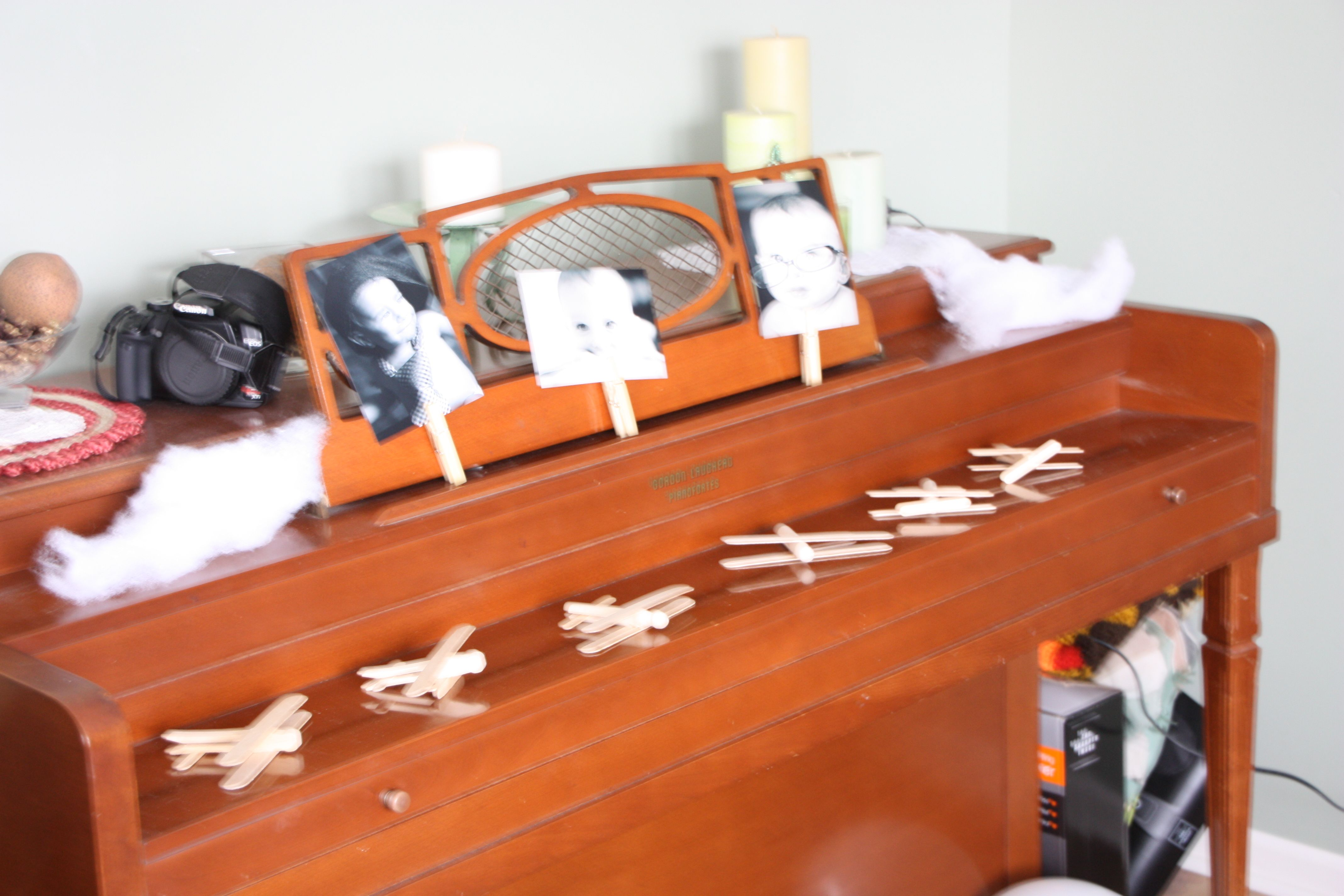 I made these airplanes out of popsicle sticks and clothes pins.  I made several but also put out the supplies for the kids to make their own.  Also on the kids table were markers so they could color them.