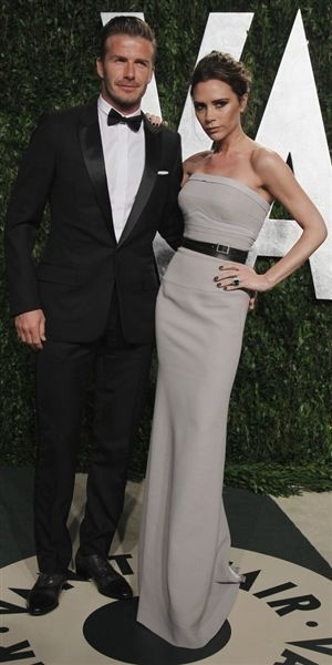 Victoria Beckham (in Victoria Beckham) and her husband, David Beckham, at the Vanity Fair Oscar Party. Hot couple!