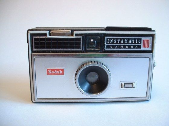 Kodak Instamatic 100 - first camera.  It had a pop up flash and you had to insert a bulb.