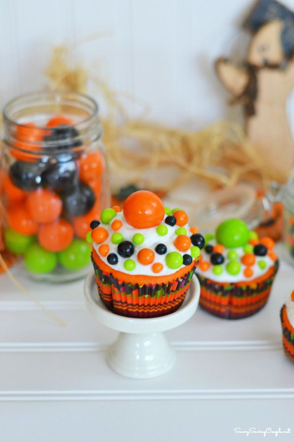 colorful halloween inspired cupcakes inspired by sixlets halloween cupcakes