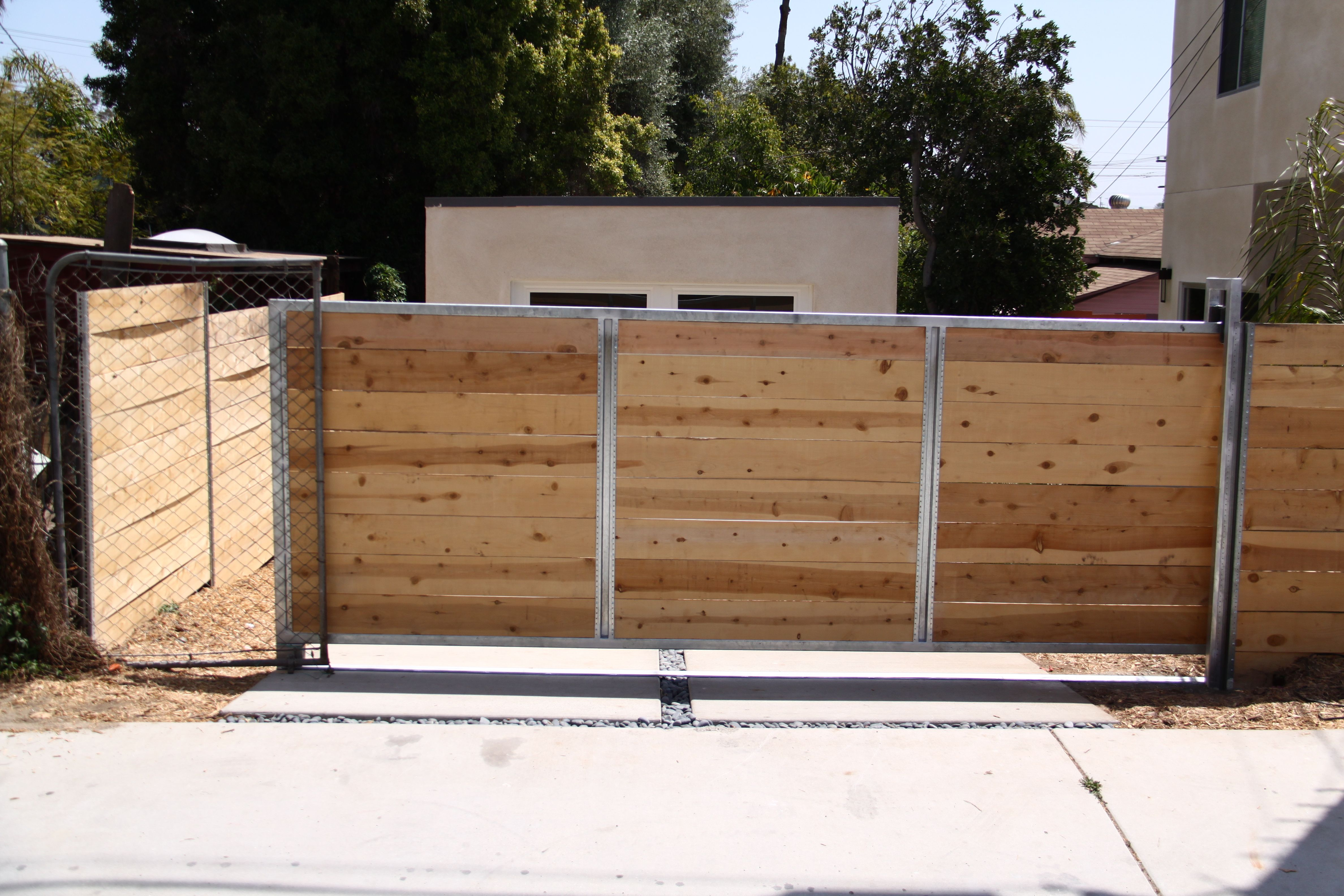 Stainless steel and wood sliding 4752 3168 for Stainless steel driveway gates designs