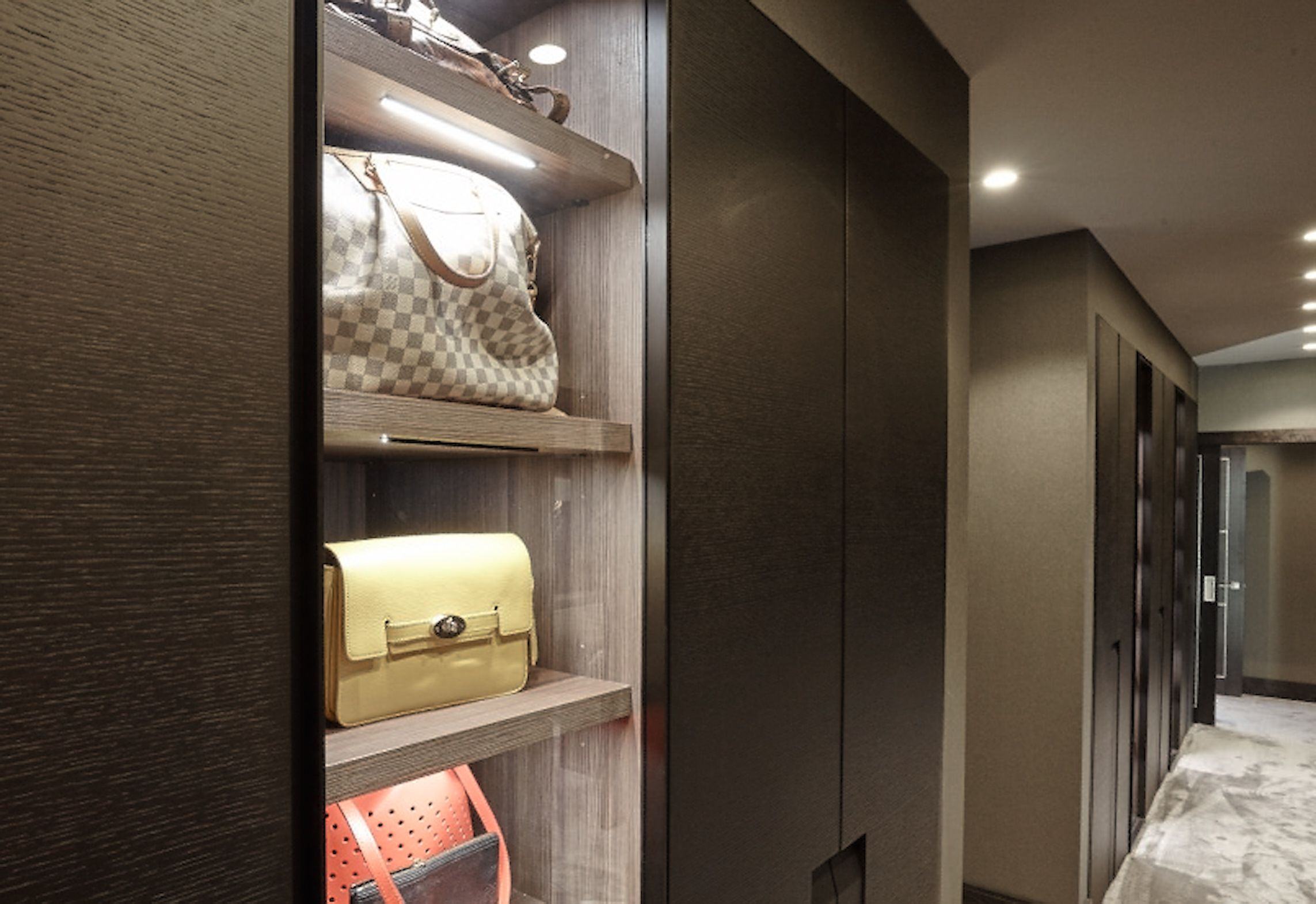 Fitted Wardrobe With Display Shelves Leading Into The Master En Suite