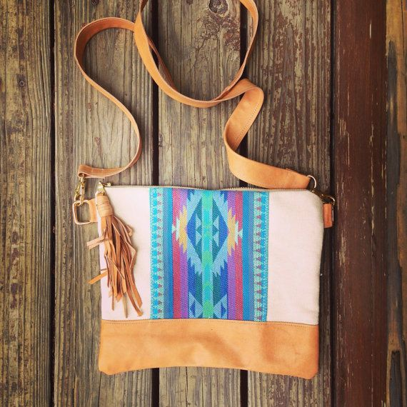 Tribal print clutch, with turquoise Aztec pattern and genuine lambskin leather base and tassel. Measures 8 inches by 10 inches wide. Cotton lining