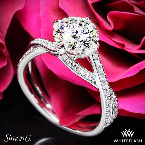 The Simon G. MR1394 Fabled Diamond Engagement Ring is part of the Fabled collection. It is embellished with 50 round brilliant melee (G/H VS, 0.14 ctw) and holds a 1.00ct center diamond.