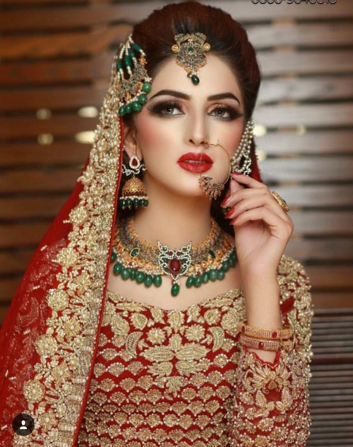 beautiful bride in red and gold. love her makeup too