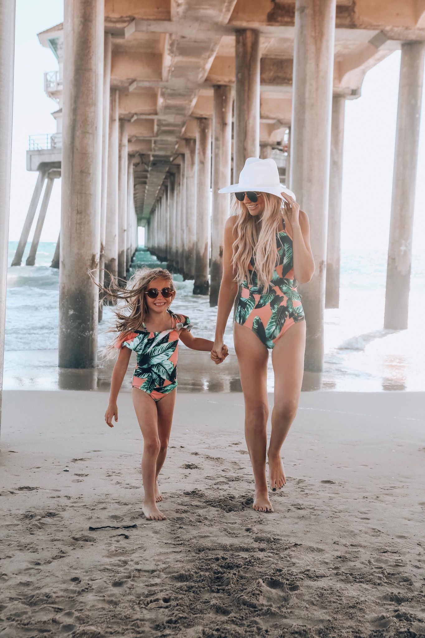 227c4ee8504d This cute mom is rocking our flattering Waikiki One Piece Swimsuit and her  daughter is wearing our NEW Mini Izabal Wave One ...