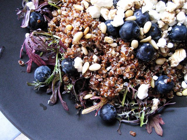 """""""Make Ahead Quinoa"""" Salad:  1. Pre-made Quinoa   2. Greens   3. Crumbled Goat Cheese  4. Pine Nuts (pine nuts are pricey – use sparingly)  5. Blueberries   6. Balsamic Vinegar (any brand)."""