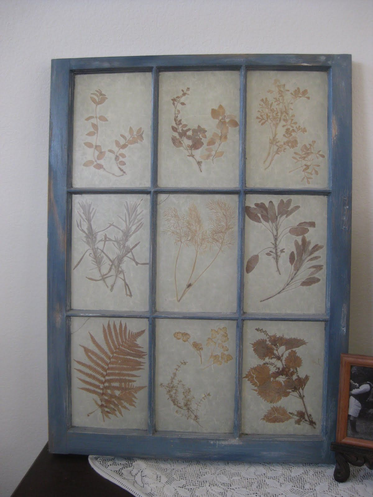 Old frame painted and sanded for worn look. Dried herbs / flowers ...