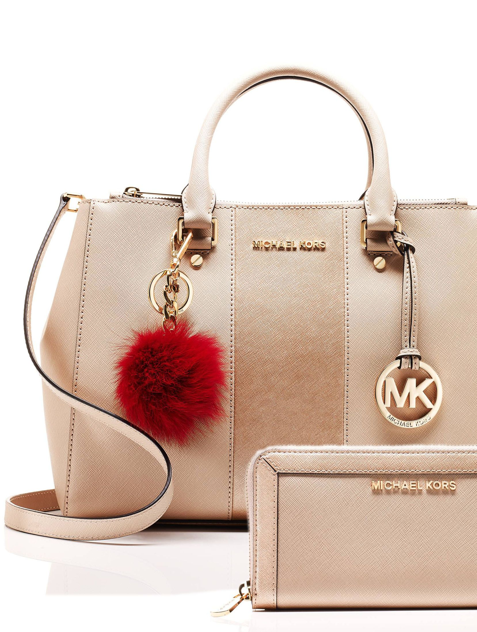 b01e08c5e2e80 Mix and match a MICHAEL Michael Kors handbag, wallet and pom charm to  create her perfect holiday gift.
