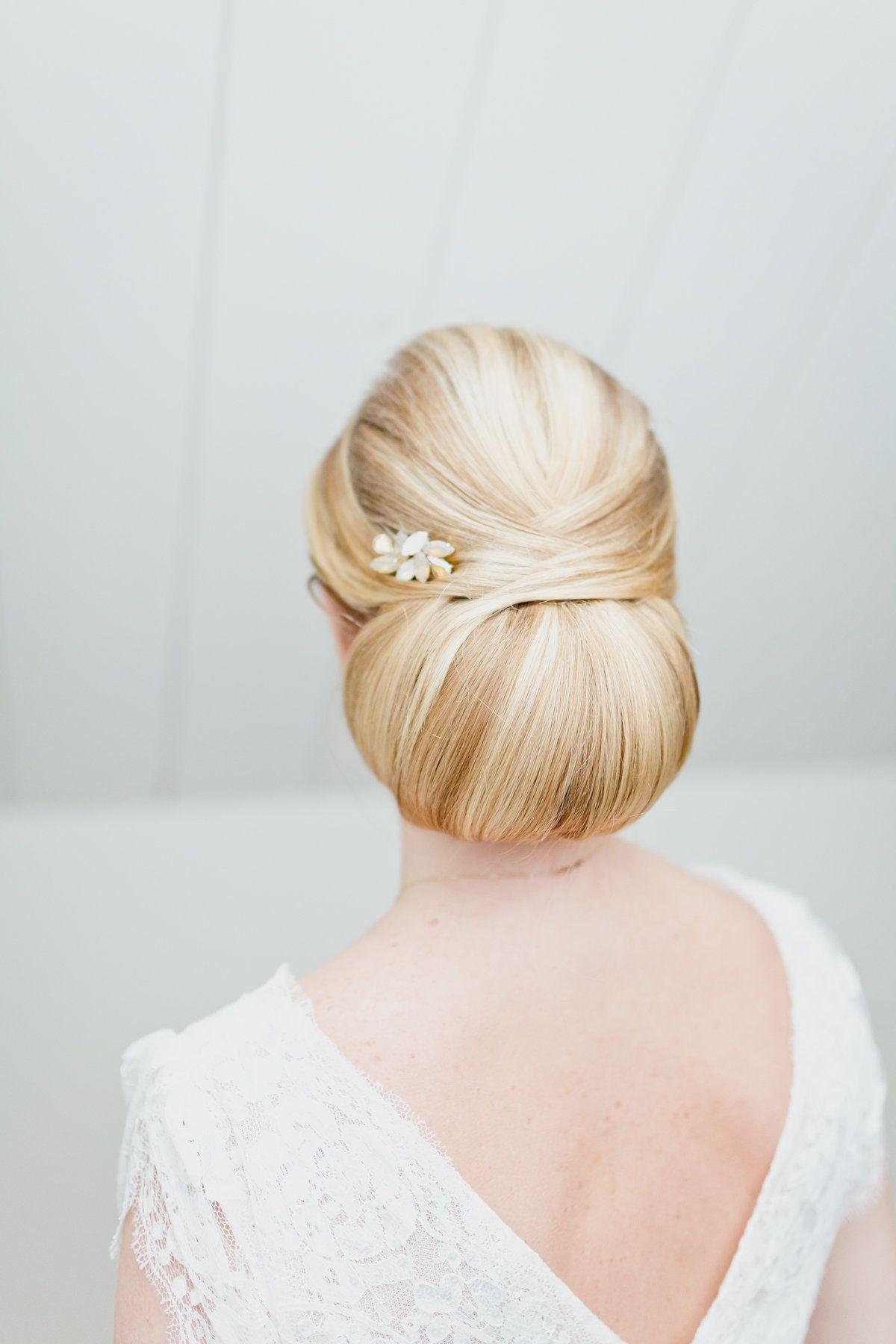 Low bun bridal hairstyle with vintage hairpins Hair by Lonneke van