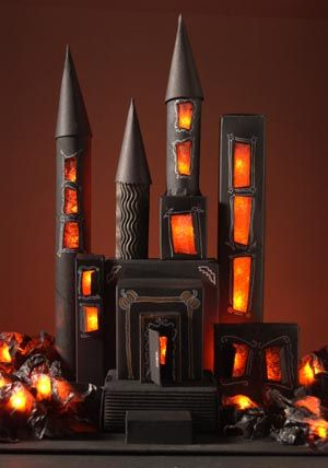 DIY Create Your Own Miniature Haunted House for Halloween...create a spooky haunted house for Halloween using mostly recycled materials found around your home!