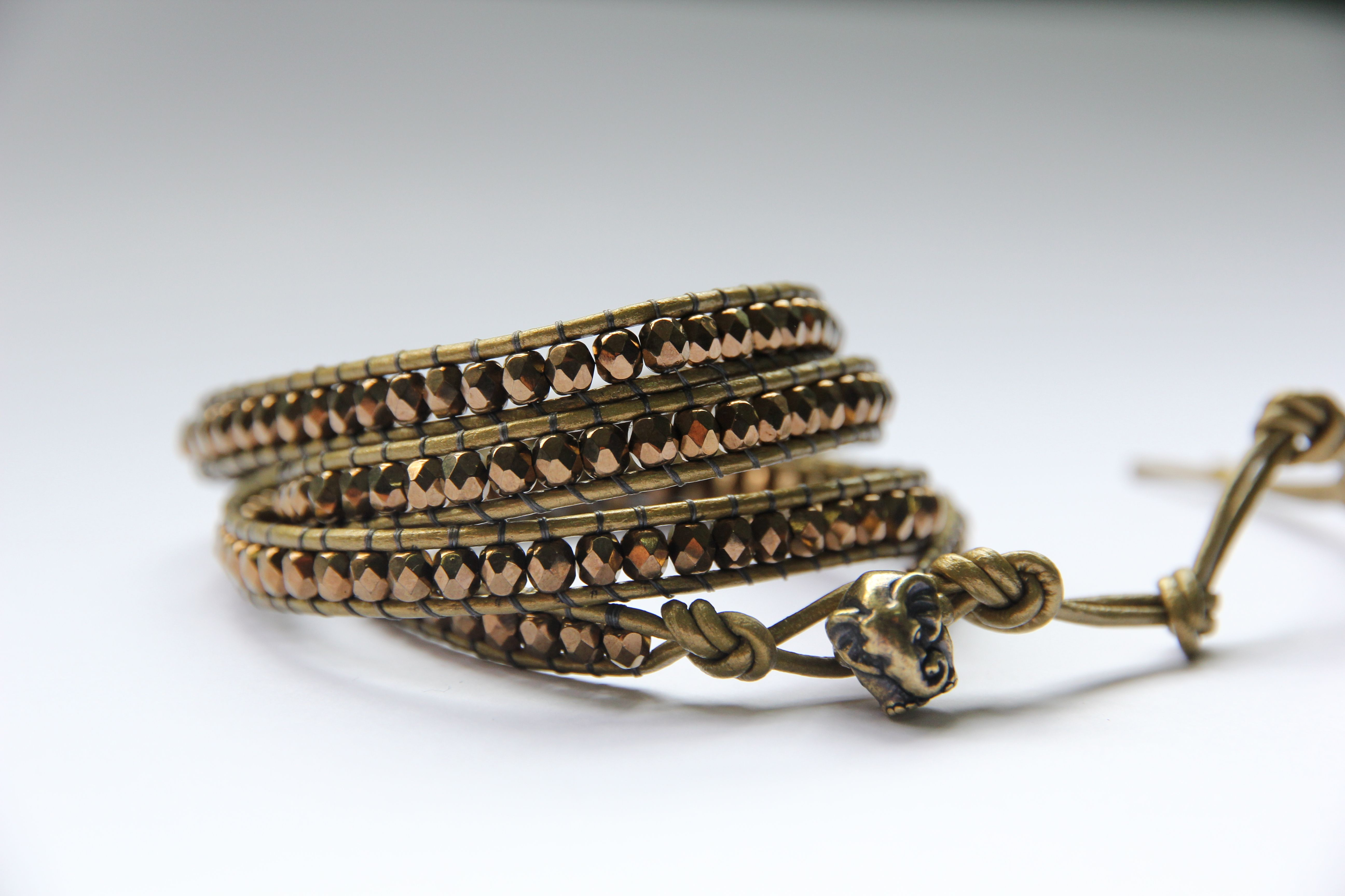 This mixed metal leather wrap bracelet takes a long time for artisans to hand stitch, but that's what makes it special. This one was designed Kenyan artisans in mind and features a large hole antique bronze elephant bead for a closure. Designed by OneMaker.com.
