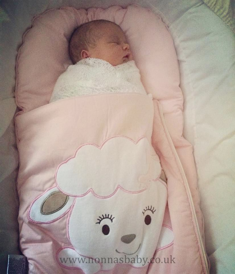 """Freya loves her Cotton Candy Nap Mat! She is gorgeous, and looks """"as snug as a bug"""". Thanks to mummy Victoria for sending us this lovely photo. :-) • Find out more about Nap Mats: https://nonnasbaby.co.uk/baby-nap-mats/"""