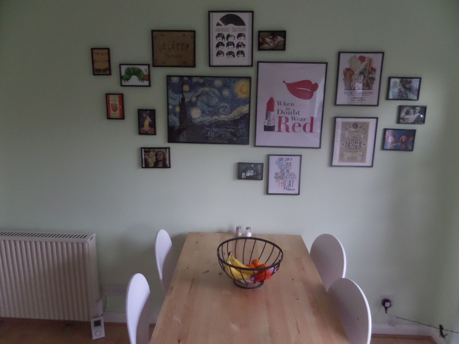 Kitchen table and picture wall.