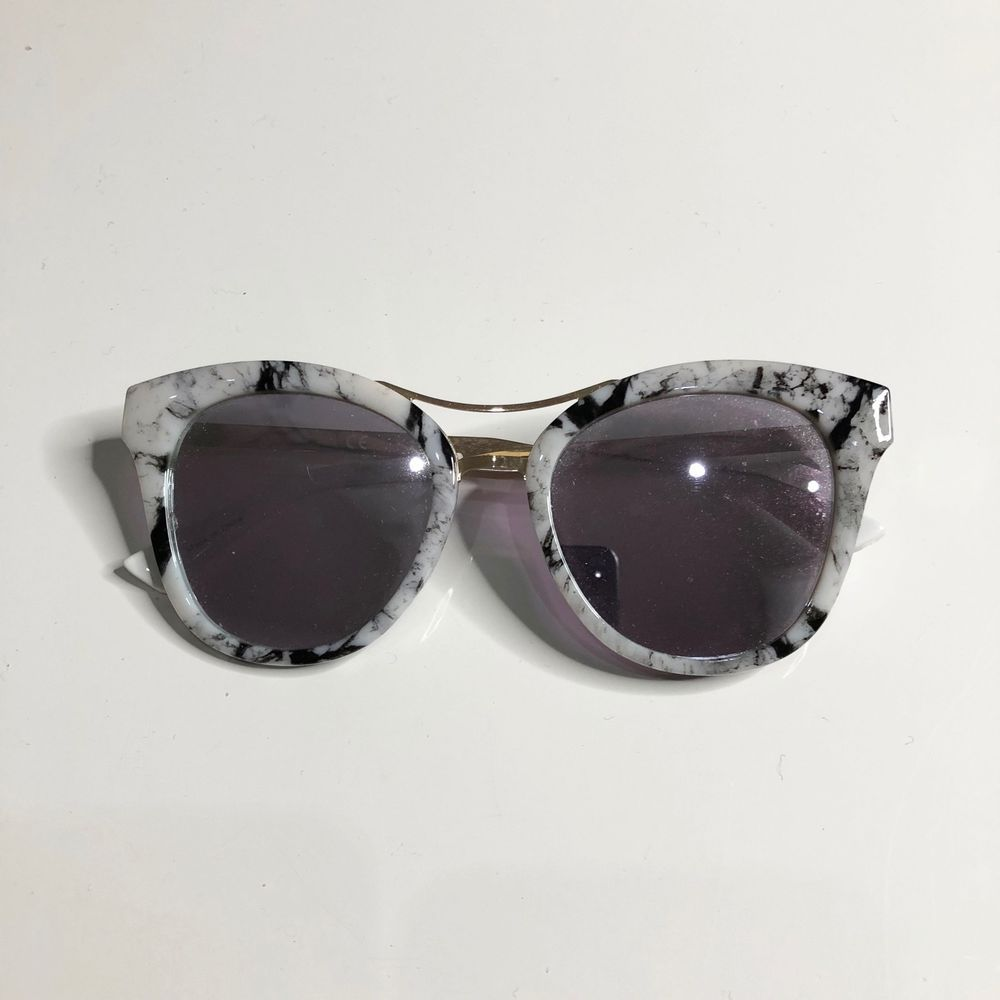 879fbd038c07 Miu Miu MU 54SS Sunglasses Fashion-forward designer style with UV  protection