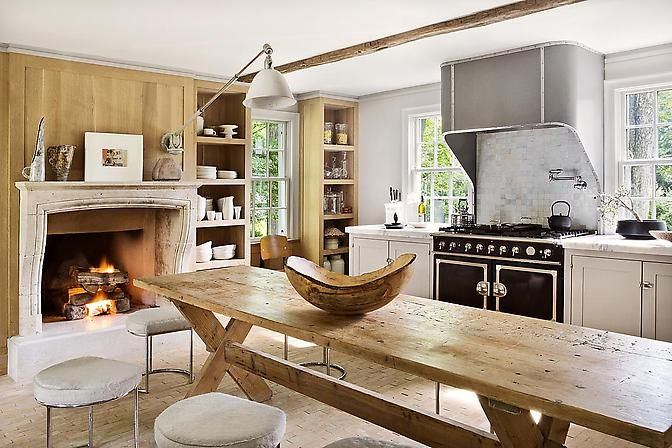 Love the architect lamp, the massive wooden table and the huge trencher bowl.