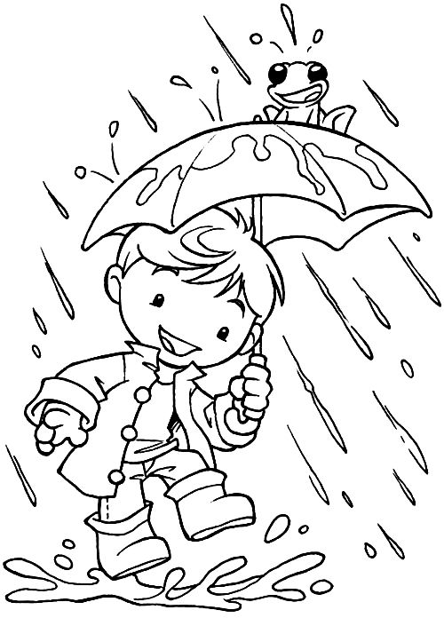 Little boy playing in the rain