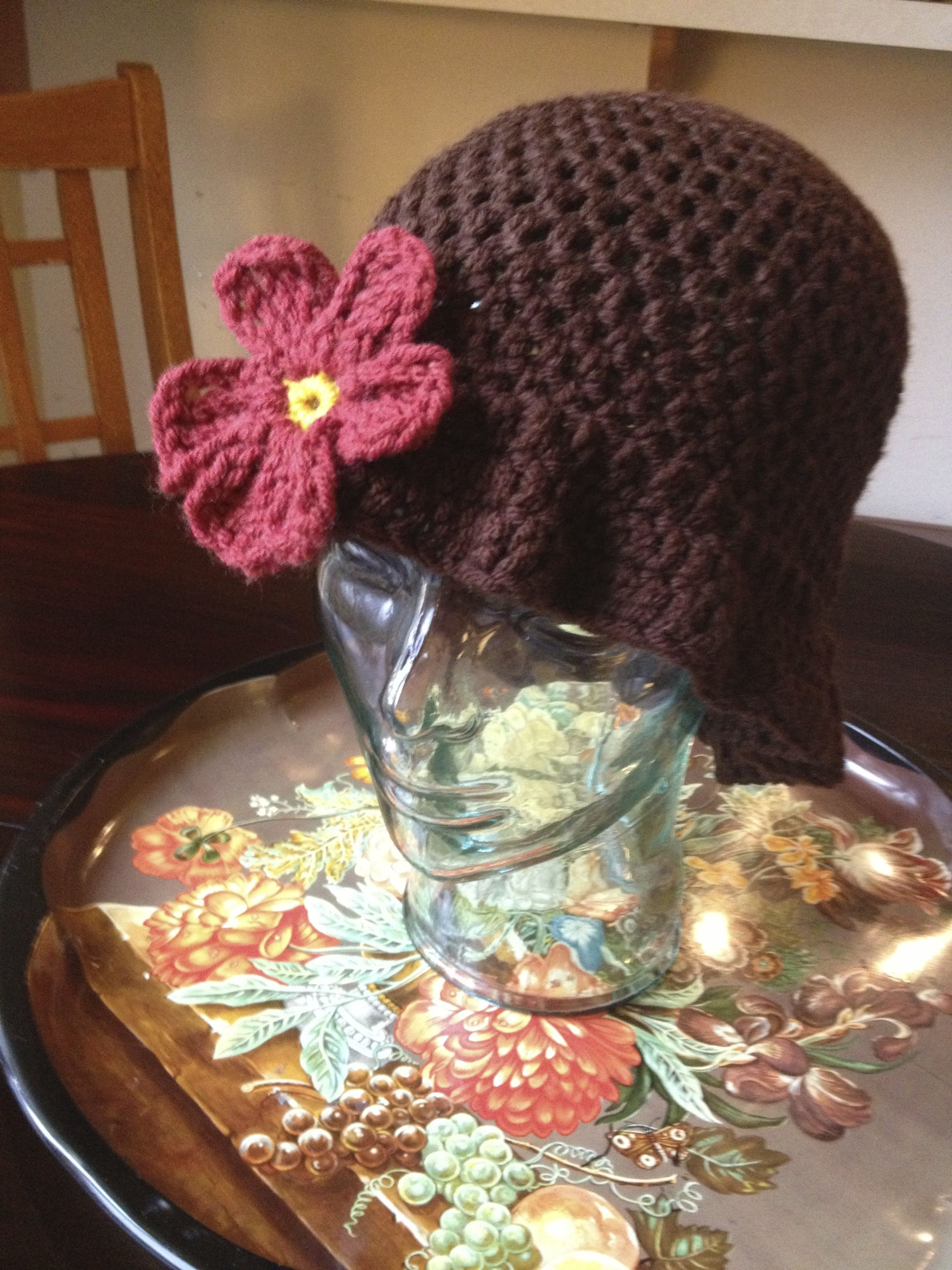 Nice and soft, the frilly brim makes things super fab and feminine. The flower is a deep red/orange that doesn't show up as dark here as it is in real life. Made from Red Heart With Love acrylic yarn with the accent from Bernat. $18 includes shipping, from cat friendly, smoke free home.