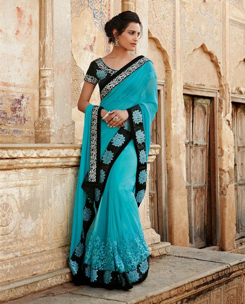 b32c3d5b13 Light blue thread embroidered sari with floral motifs border 1. Light blue  poly georgette sari2. Comes with matching unstitched blouse