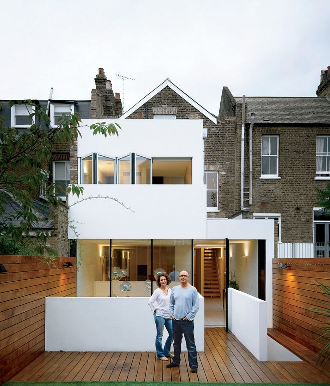 Victorian in the front, modern in the back: A couple re-energized their Victorian terrace house in London by adding a bright, white modern addition //