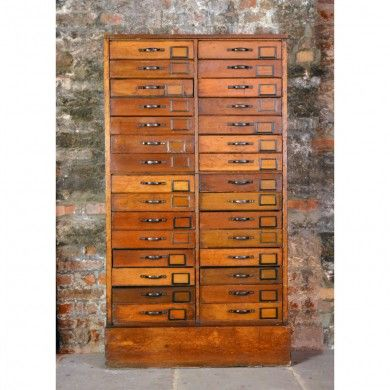 An oak and maple bank of drawers,