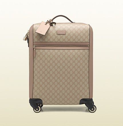 900a69105c1f Gucci GG Supreme canvas four wheel carry-on suitcase | Shopaholics ...